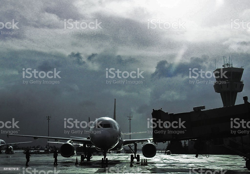 Airliner at gate in storm stock photo