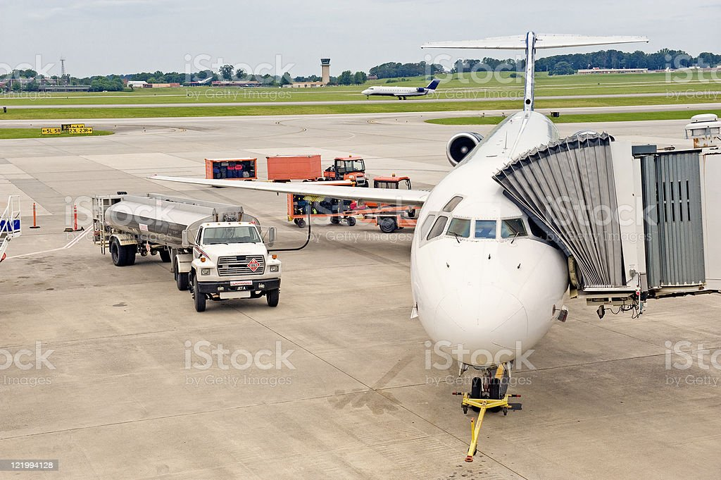 Airliner Being Serviced Between Flights While Another Lands stock photo