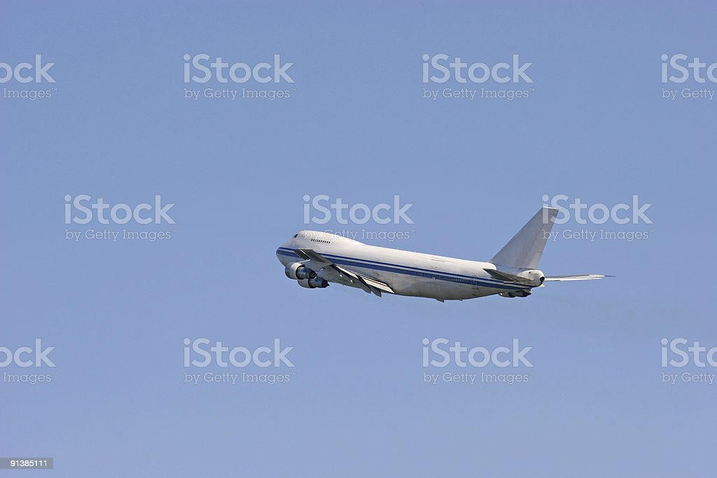 Airliner climbing into blue sky royalty-free stock photo