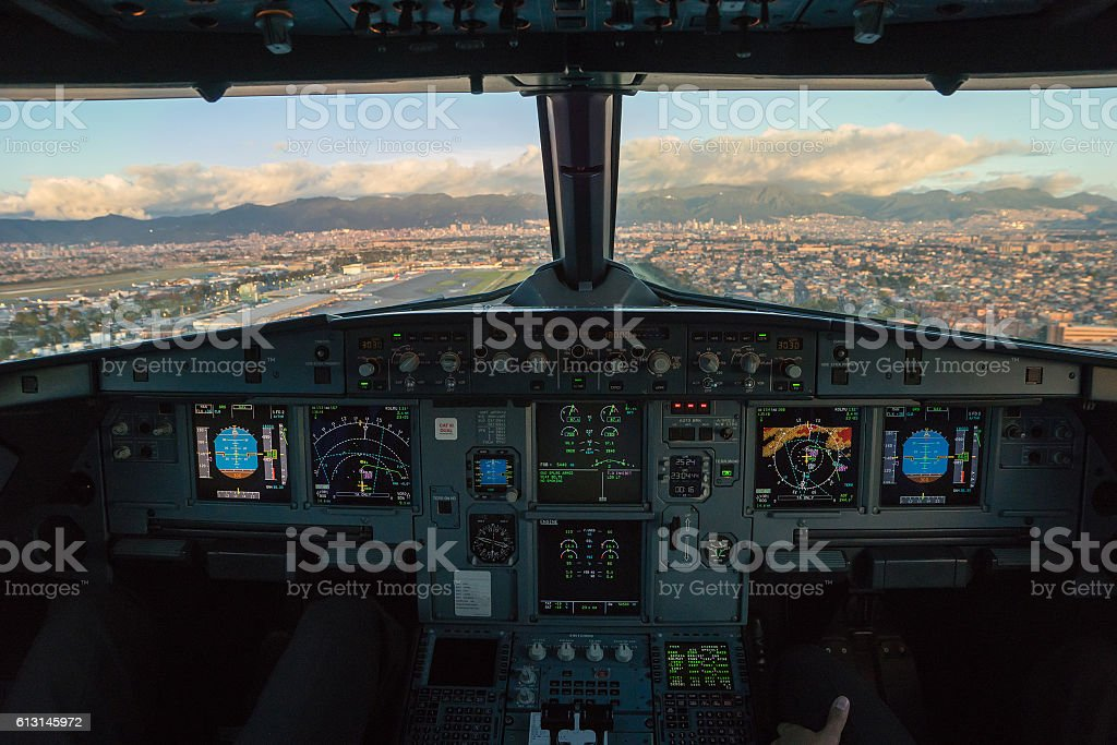 Airliner cockpit after takeoff from Bogotá stock photo
