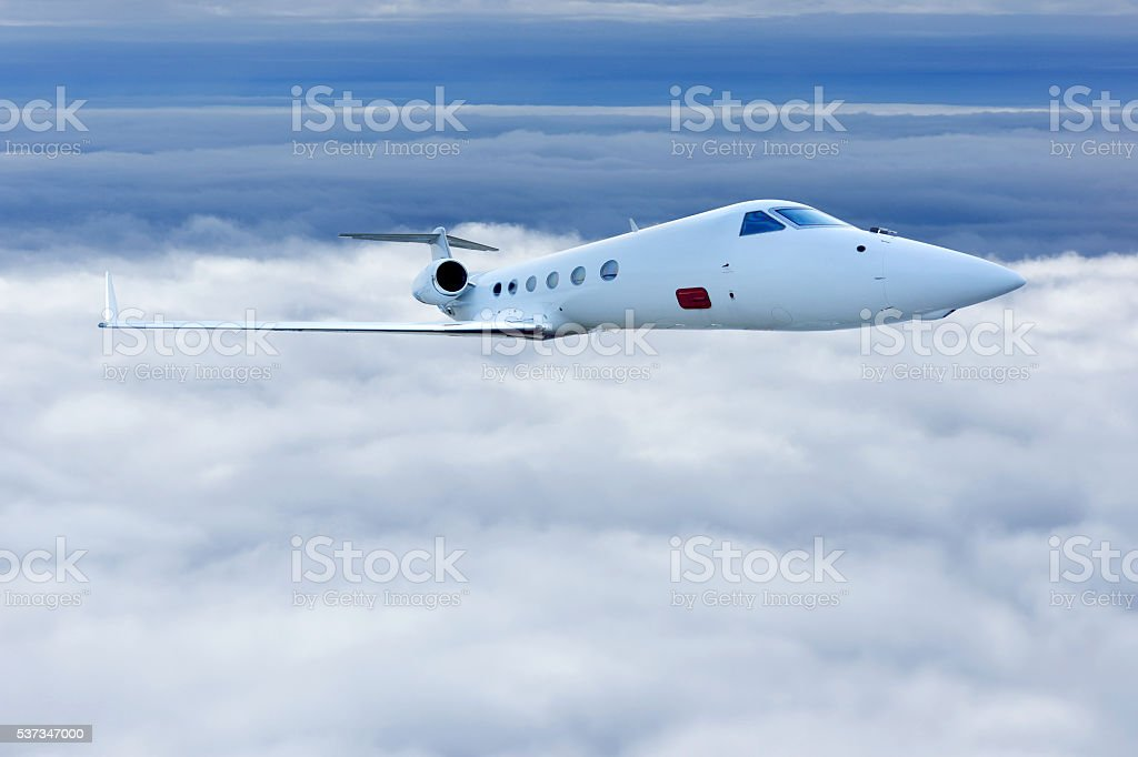 Airliner Flight in Blue Sky stock photo