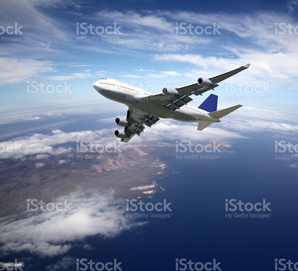 Airliner high above ground in the sky stock photo