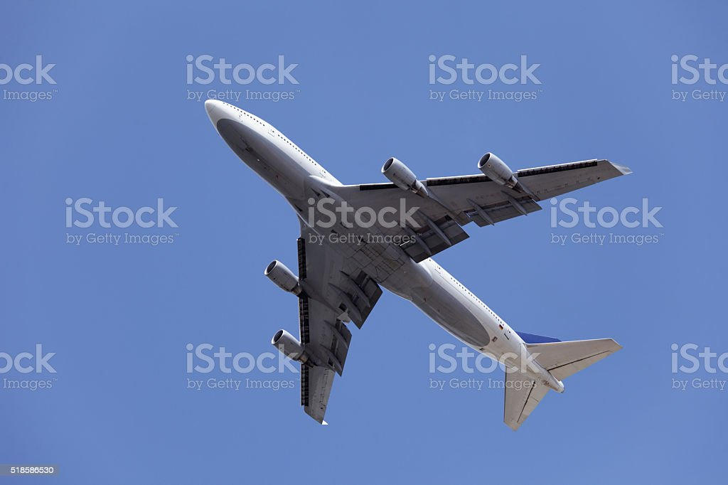 Airliner in blue sky stock photo