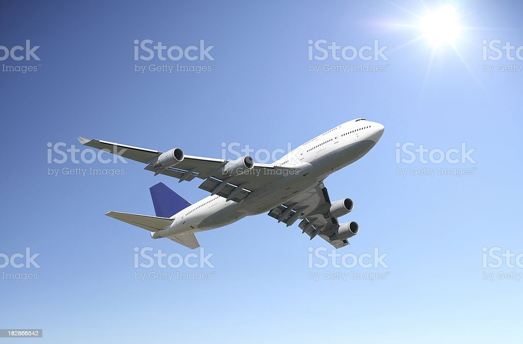 Airliner in clear sunny sky stock photo
