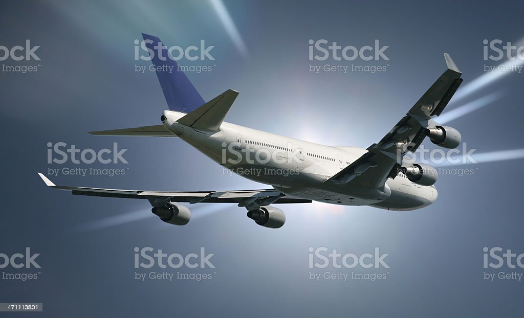 Airliner in sunbeam sky royalty-free stock photo