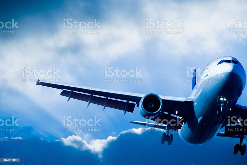 Airliner landing in a Storm stock photo