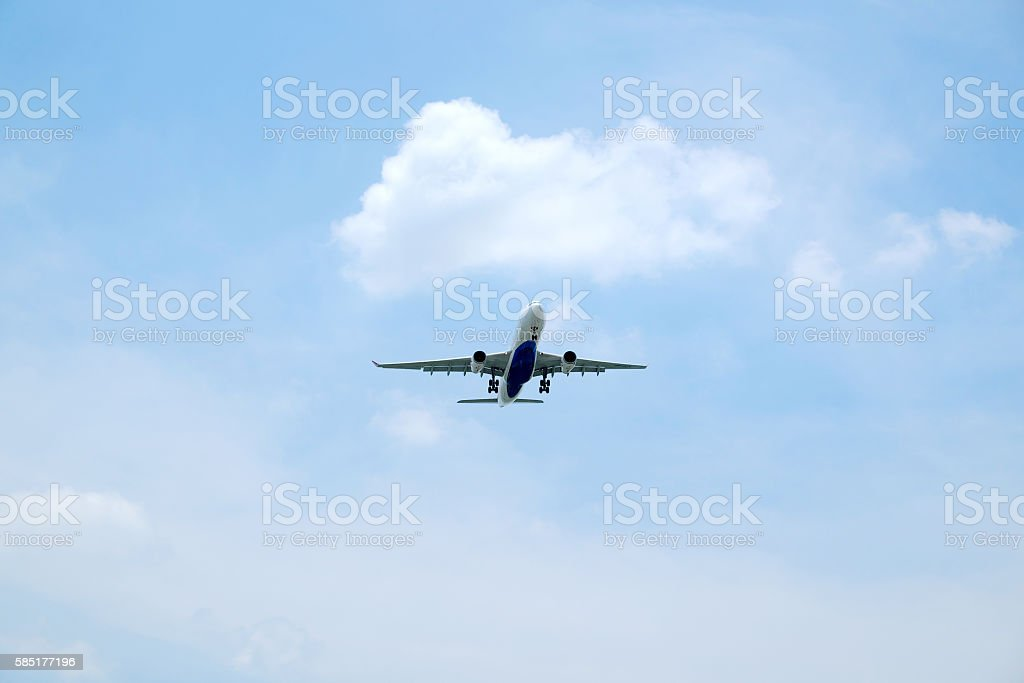 airliner landing in the sky stock photo