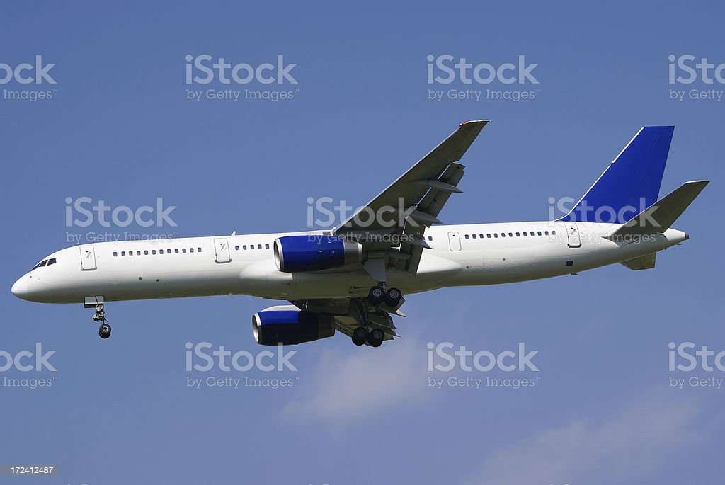 Airliner landing on sunny day royalty-free stock photo