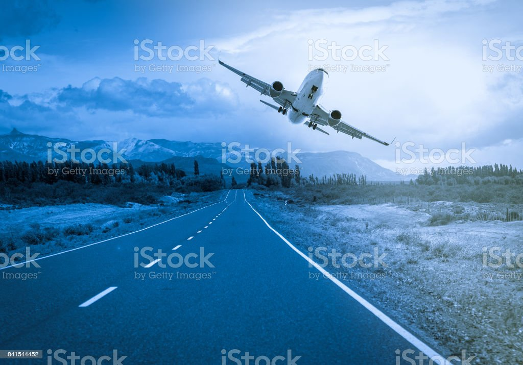 Airliner over highway stock photo