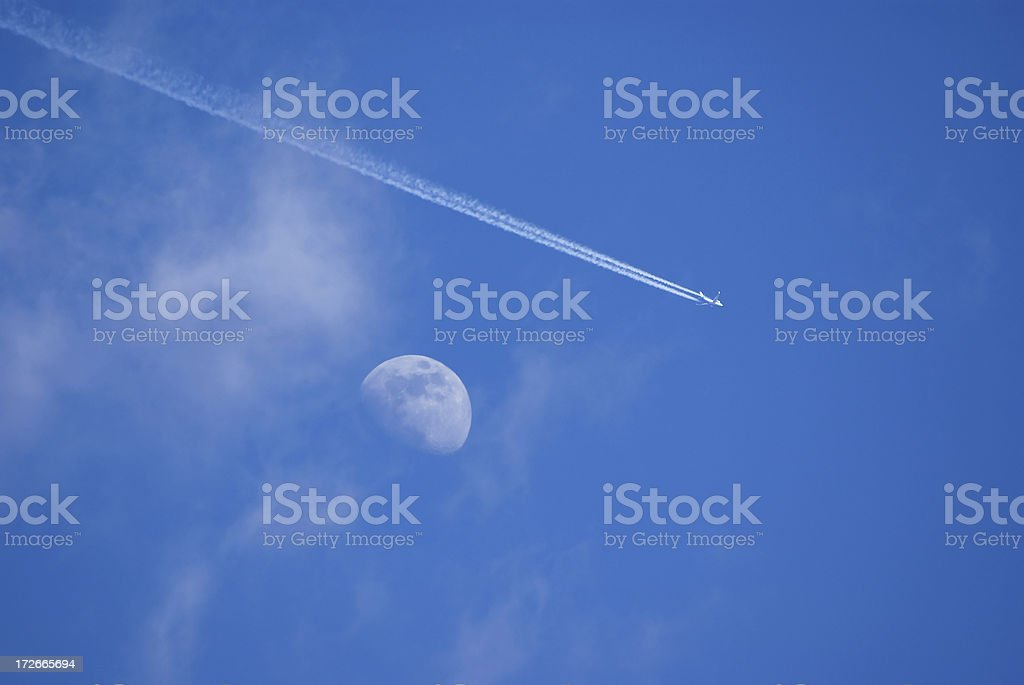 Airliner passing the moon royalty-free stock photo