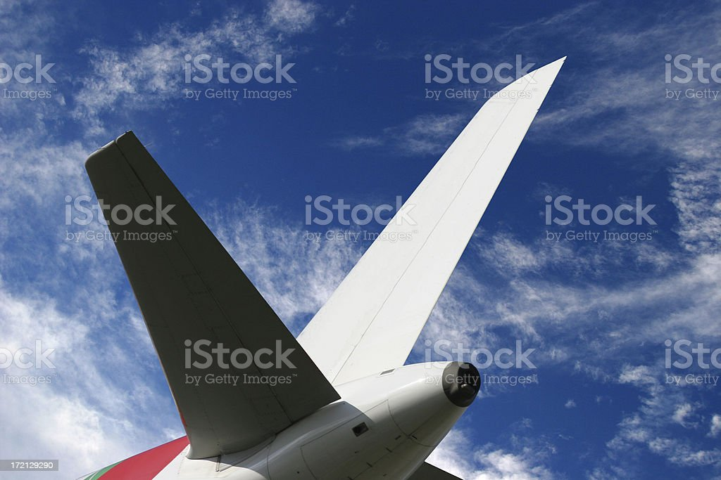 Airliner tail wing in blue sky royalty-free stock photo