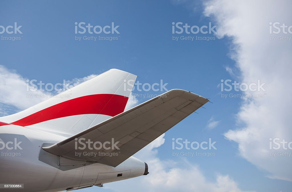 Airliner tail wing in blue sky stock photo
