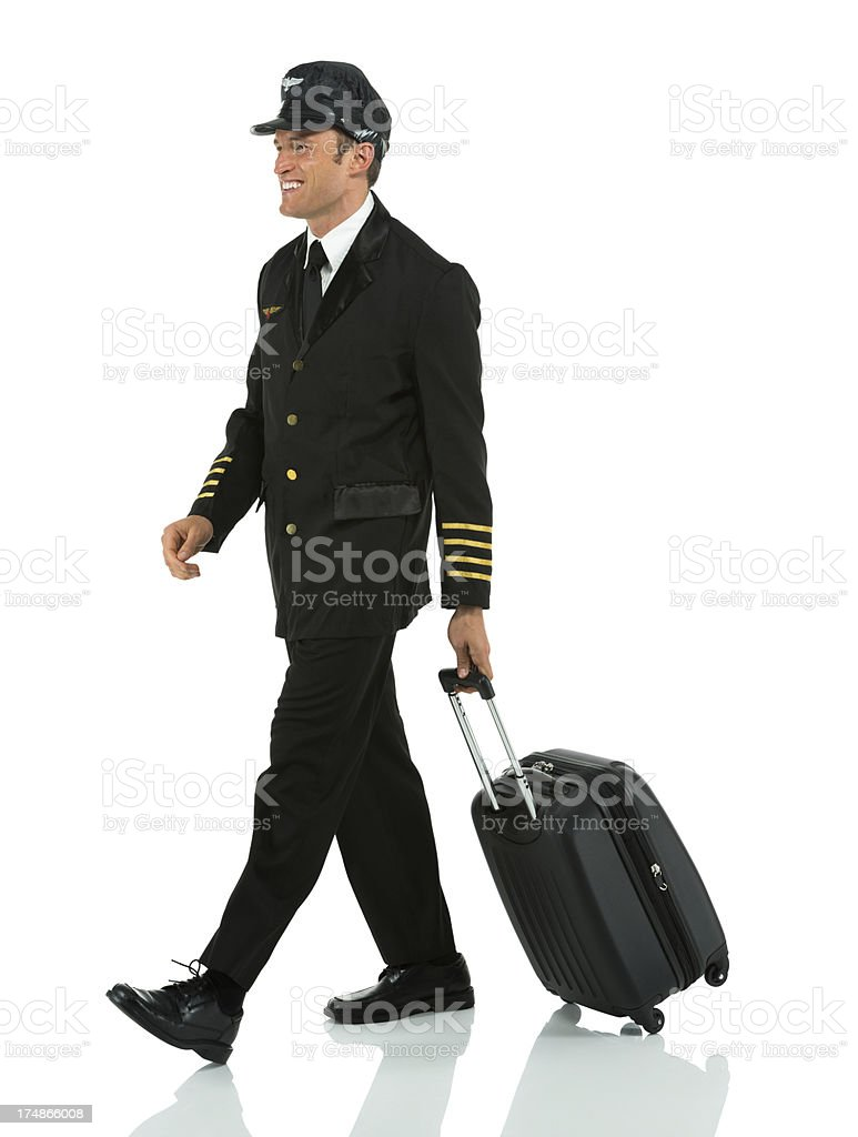 Airlines pilot walking with travel bag royalty-free stock photo