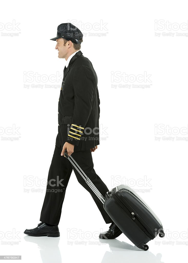 Airlines pilot walking with travel bag stock photo