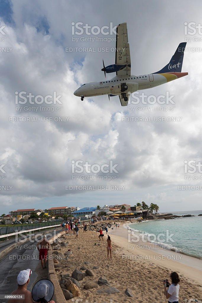 LIAT Airlines plane landing on St. Maarten stock photo