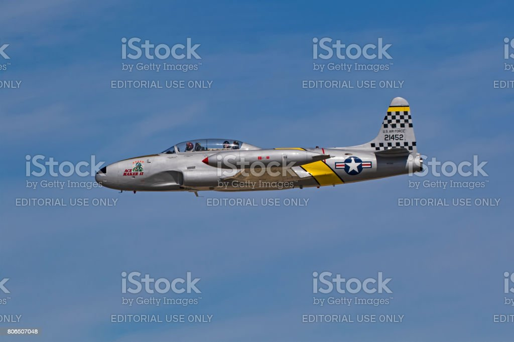 Airpalne T-33 Shooting Star fighter aircraft flying during air show stock photo