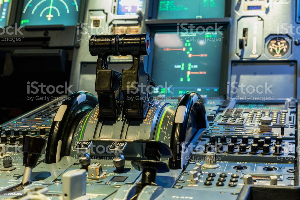 Airplan control stick in side pilot cockpit. Engine lever in the cockpit of an airliner stock photo