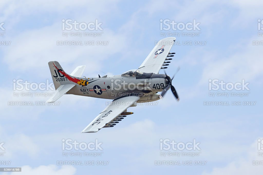 Airplane A1 SkyRaider flying at air show stock photo
