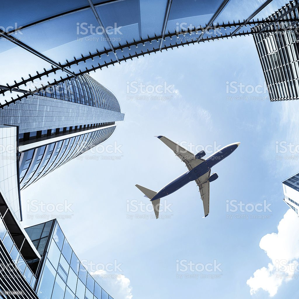 Airplane above City Financial District royalty-free stock photo