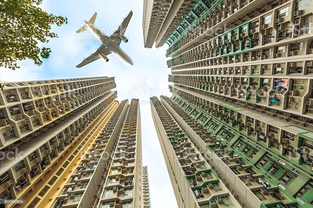 Airplane above residential district stock photo