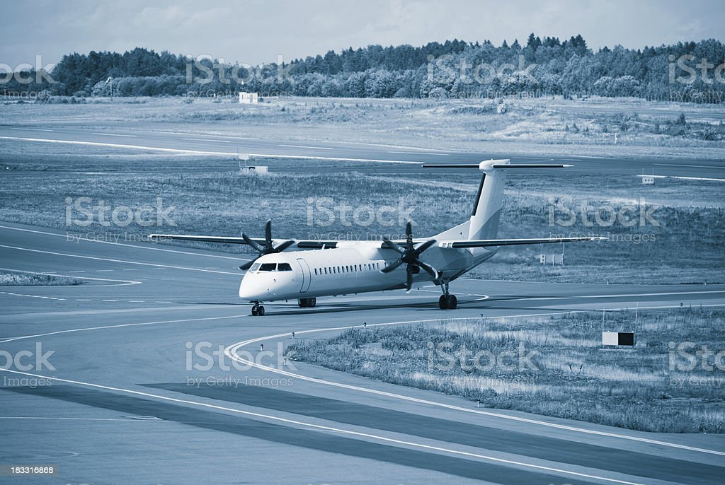 Airplane after  take-off - Blue Toned stock photo