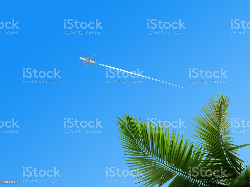 Airplane & airtrack in the blue sky stock photo