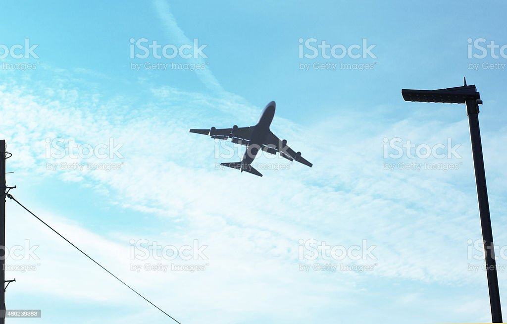 Airplane and blue sky stock photo