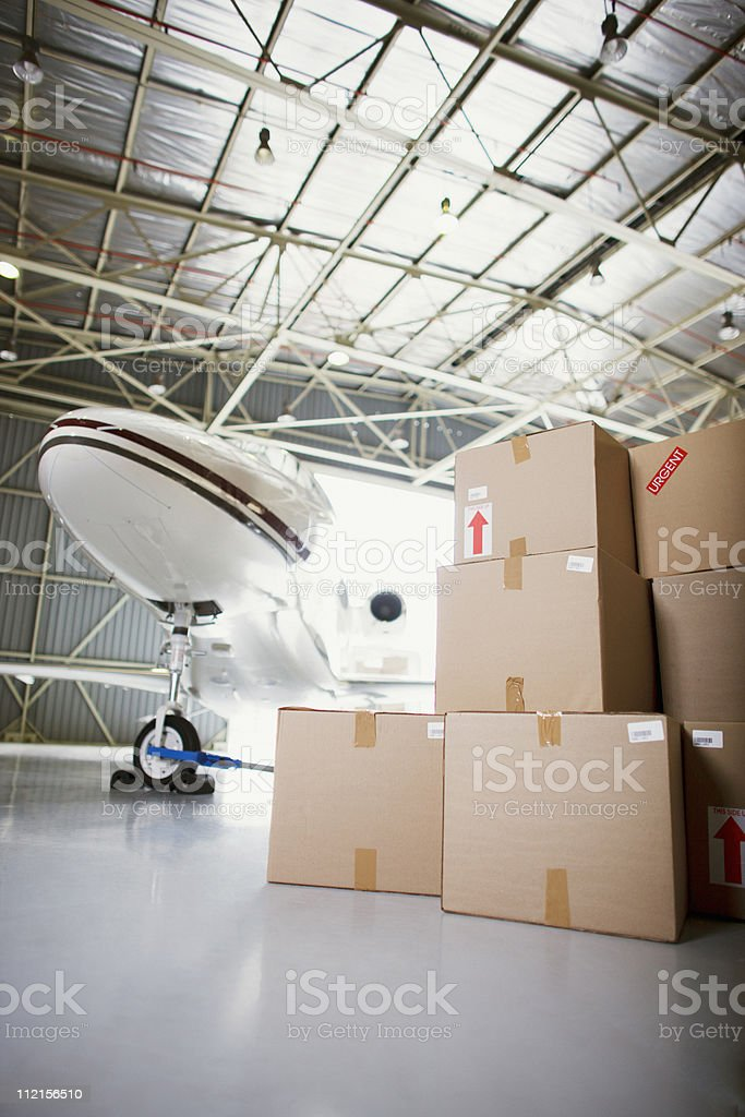Airplane and boxes in hangar royalty-free stock photo