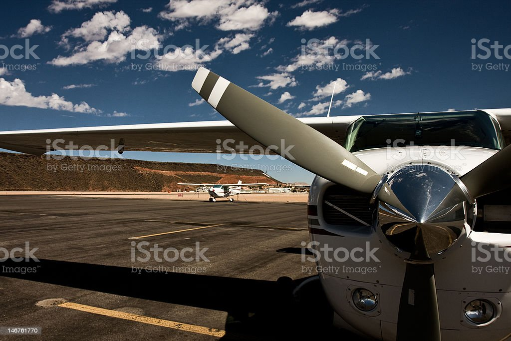 Airplane and clouds stock photo