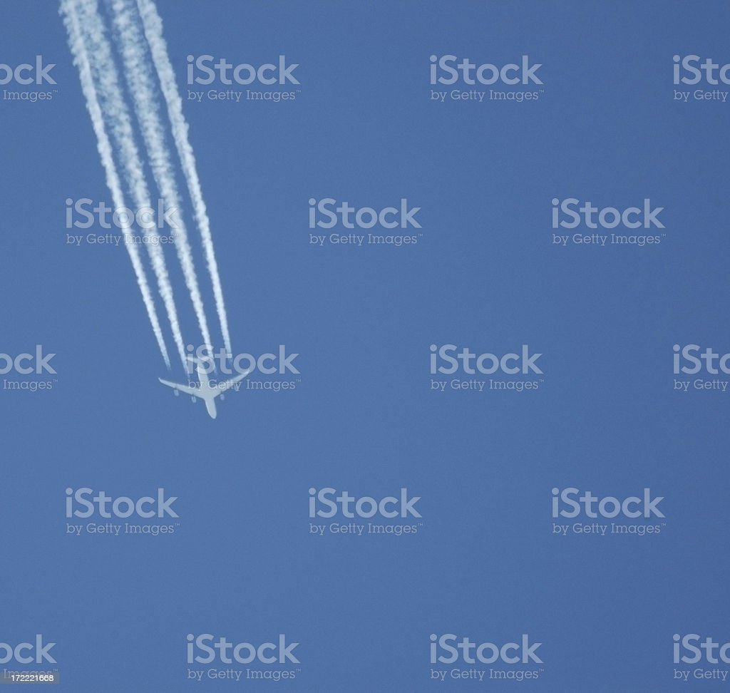 Airplane and Con Trails royalty-free stock photo