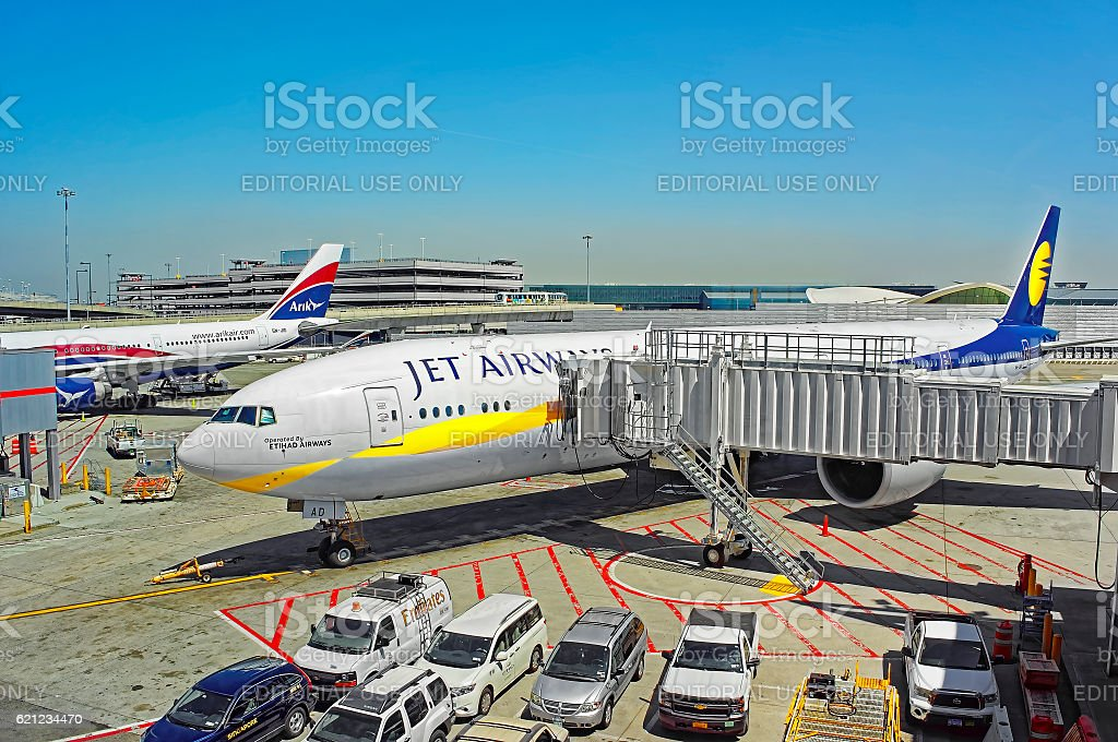 Airplane and jet bridge at JFK international airport stock photo