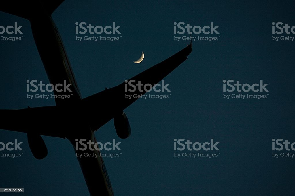 airplane and moon stock photo
