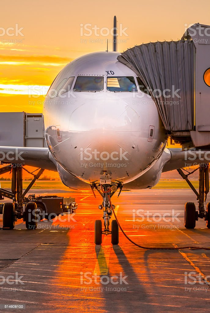Airplane and sunset stock photo