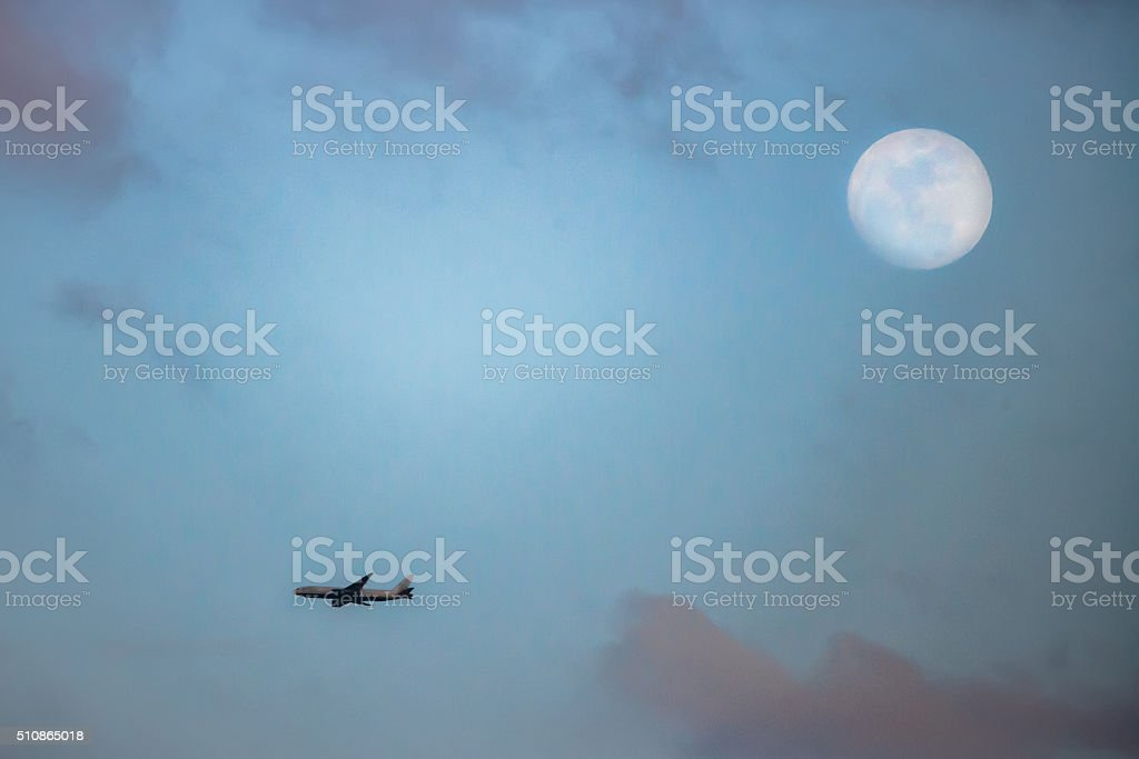 Airplane and the Moon stock photo