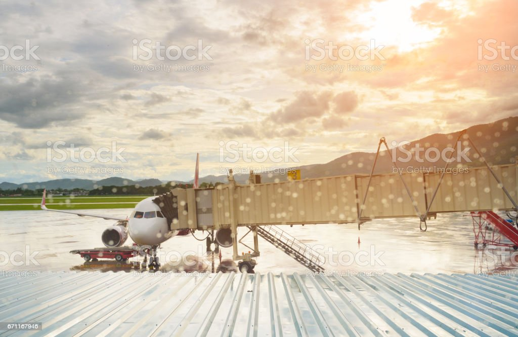 Airplane and tunnel in airport terminal stock photo