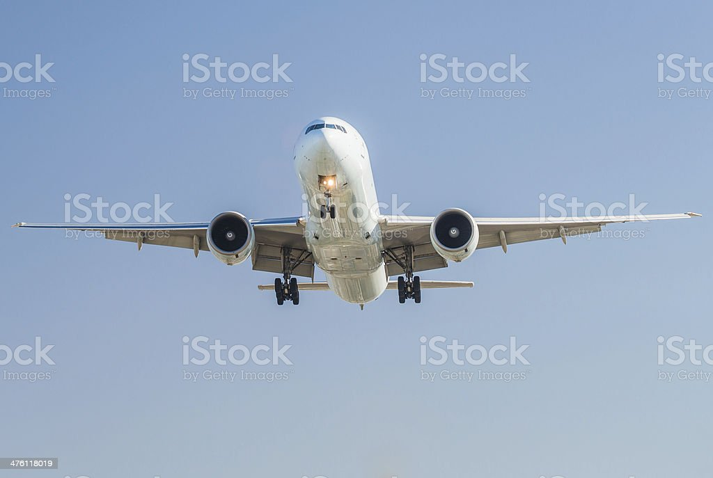 Airplane approaching head on for landing stock photo