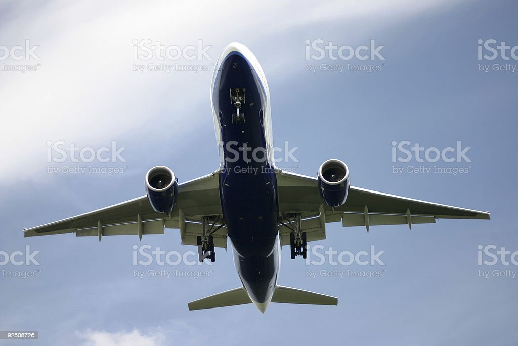 Airplane approaching stock photo