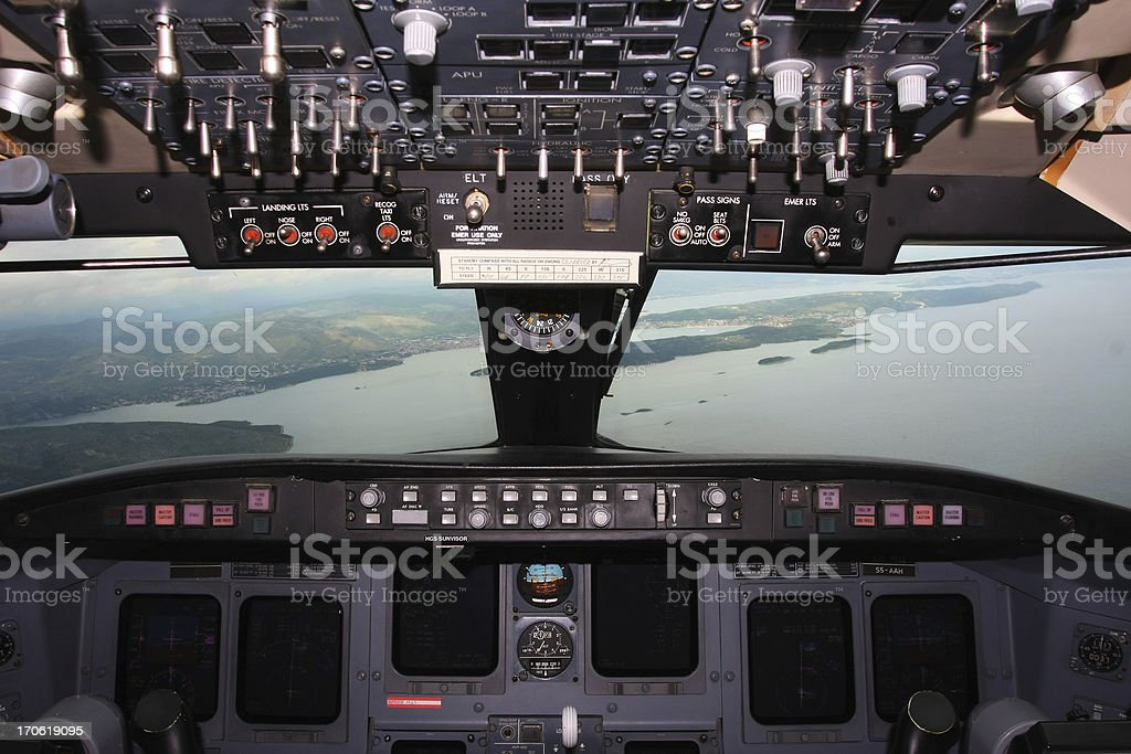 Airplane approaching to the airport royalty-free stock photo