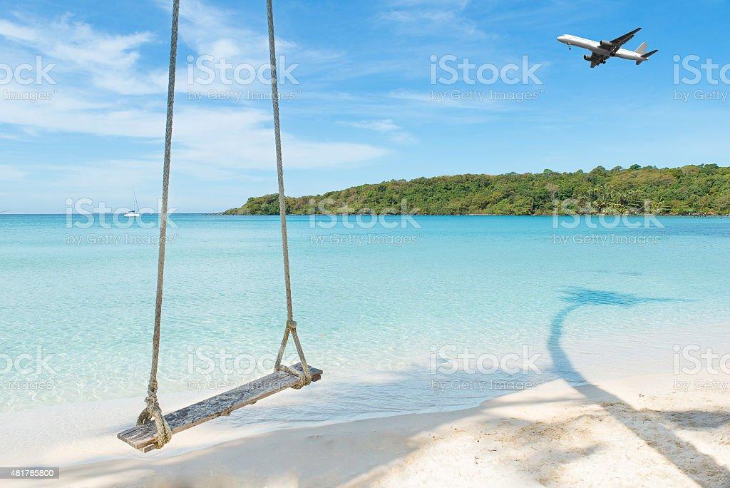 Airplane arriving tropical beach sea in Phuket ,Thailand. stock photo