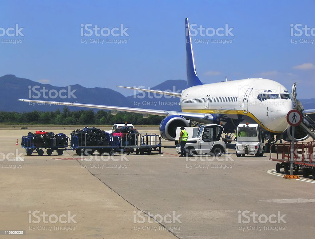 Airplane at airport royalty-free stock photo