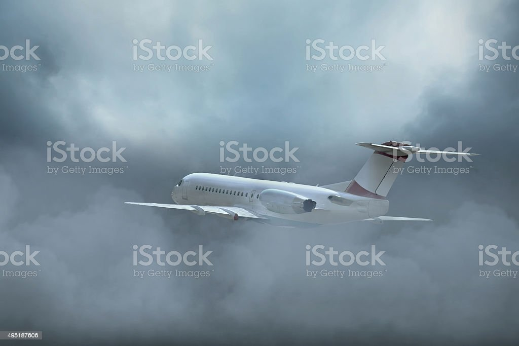 Airplane at fly on the sky with clouds stock photo