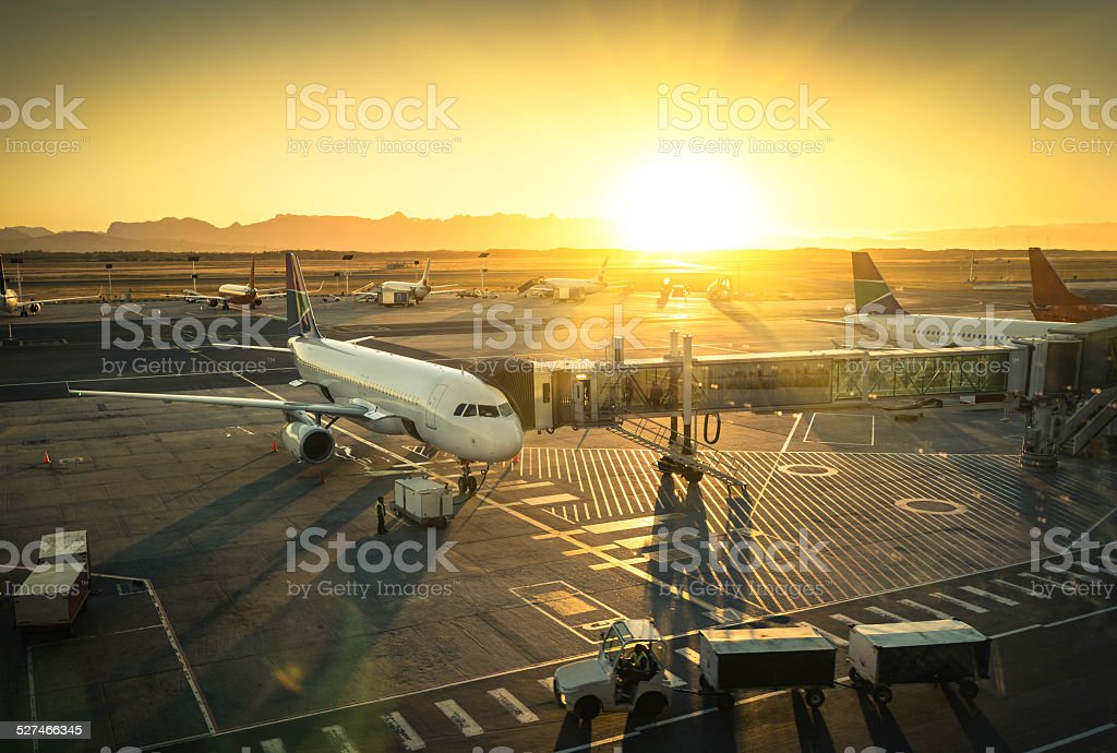 Airplane at international airport terminal gate ready for takeoff stock photo