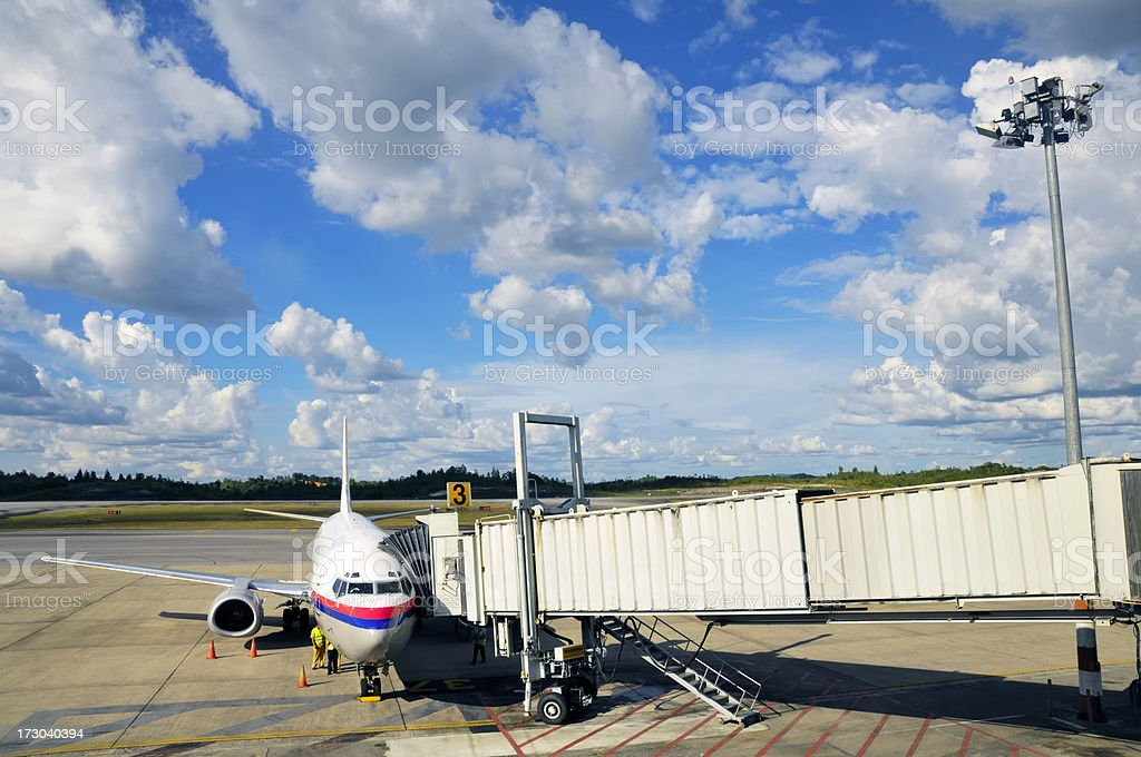 Airplane at its parking bay stock photo