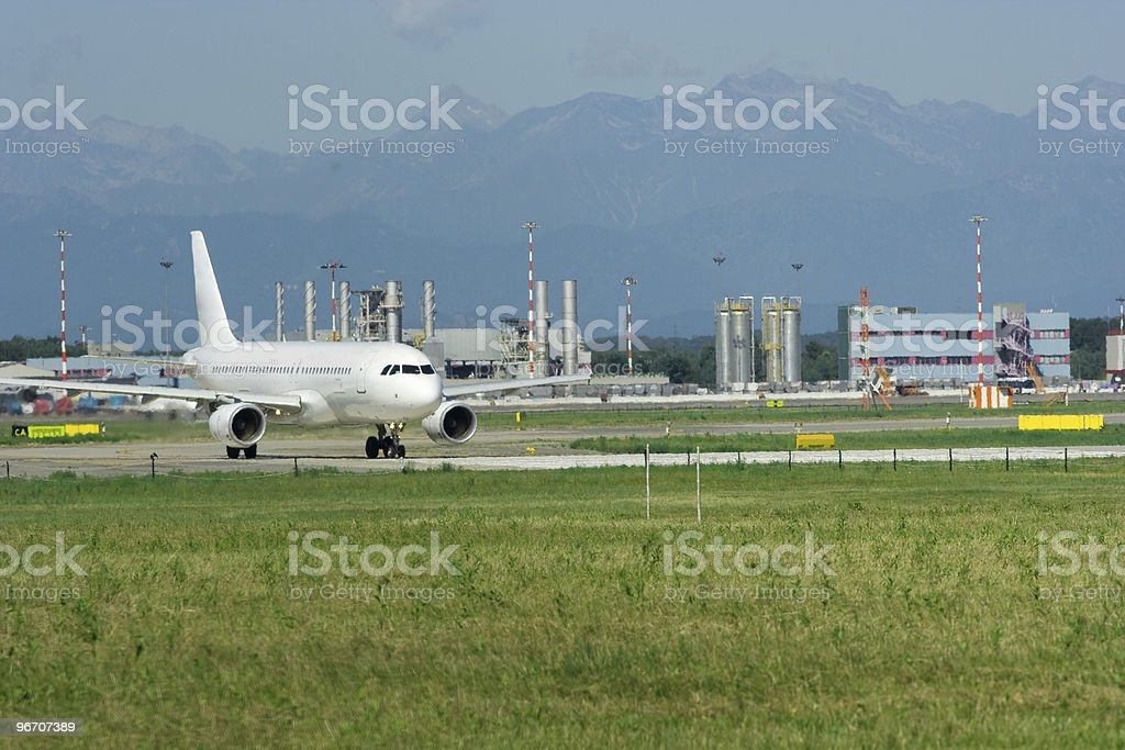 Airplane at Malpensa Airport Taking Off royalty-free stock photo