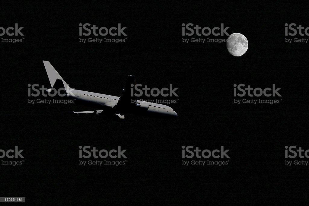 Airplane at midnight royalty-free stock photo