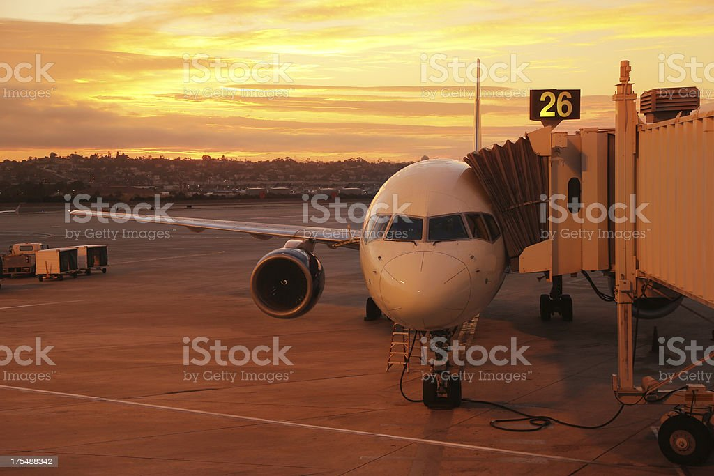Airplane at Sunrise in San Diego Fueling Up stock photo
