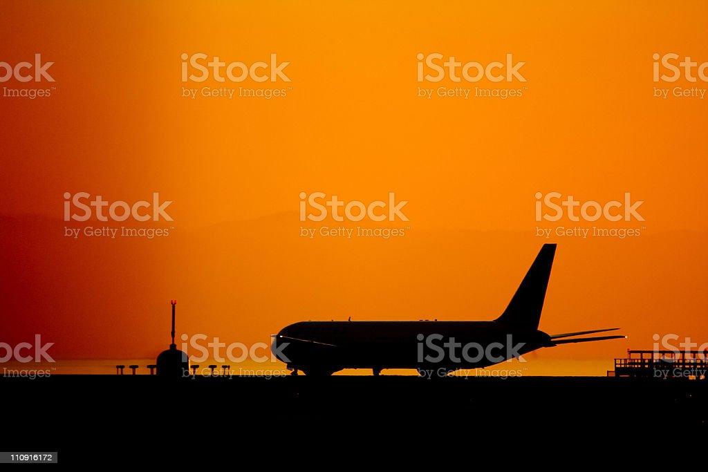airplane at sunset stock photo