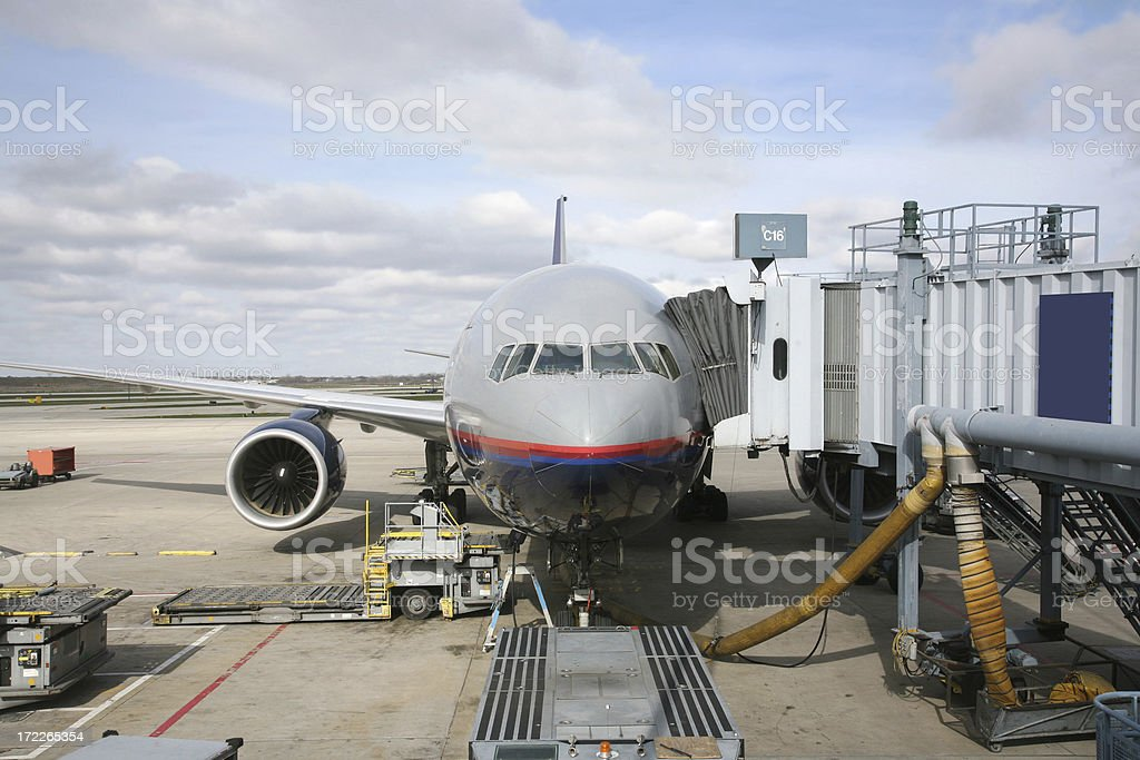 Airplane At Terminal Gate, Being Serviced stock photo