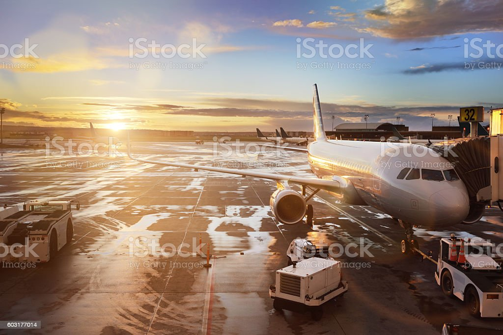 Airplane at terminal gate in international airport stock photo