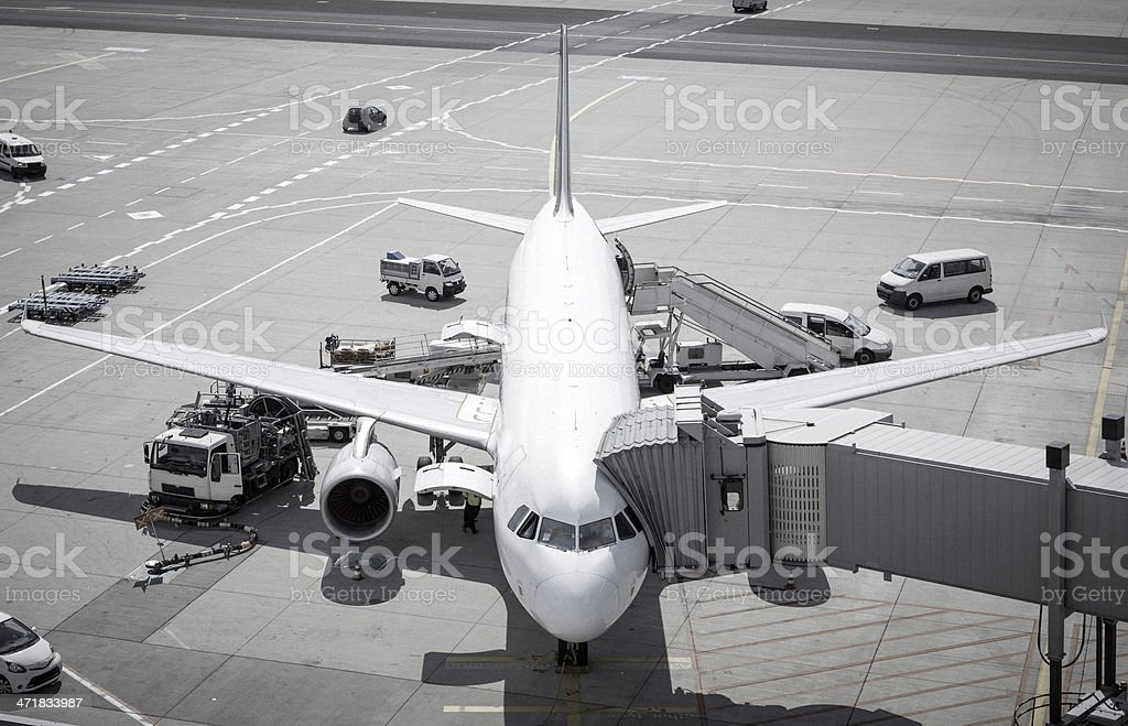 Airplane at the airport stock photo